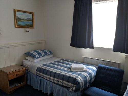 A bed or beds in a room at Woodlea