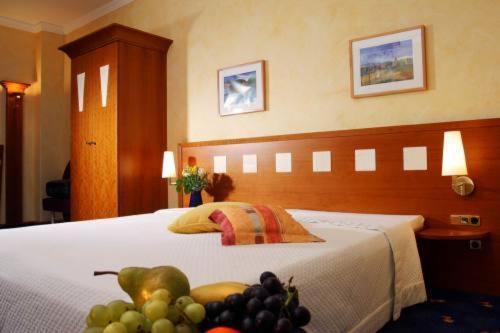 Ein Bett oder Betten in einem Zimmer der Unterkunft Metzgerei Hotel Gasthof Wittmann
