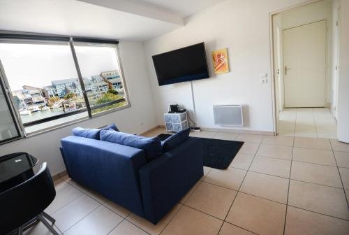A television and/or entertainment center at APPT MARINA DE DEAUVILLE
