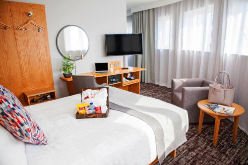 A television and/or entertainment center at Ramada by Wyndham Belfast