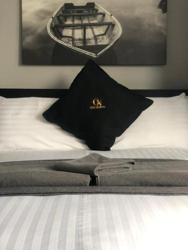 A bed or beds in a room at Citi North