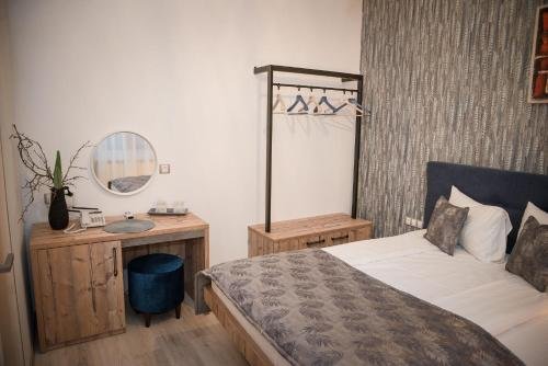 A bed or beds in a room at ART Hotel