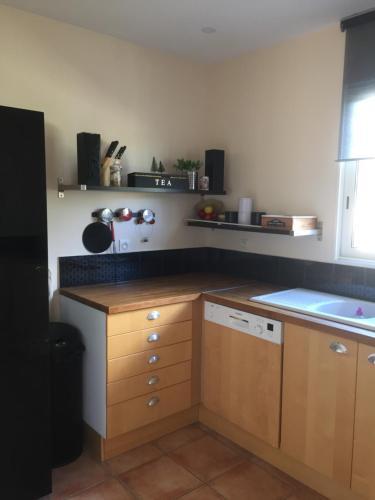 A kitchen or kitchenette at La Bastide