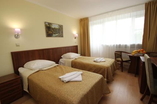 Кровать или кровати в номере Санаторий Виктория