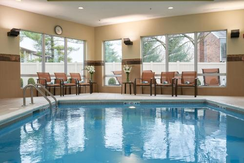 The swimming pool at or near Courtyard by Marriott Evansville East
