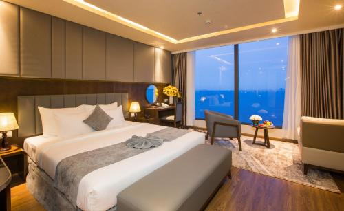 A bed or beds in a room at DTX Hotel Nha Trang
