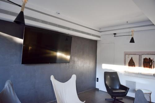A television and/or entertainment center at Adonis City Hotel