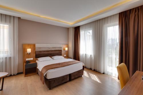 Кровать или кровати в номере City Hotel Batumi