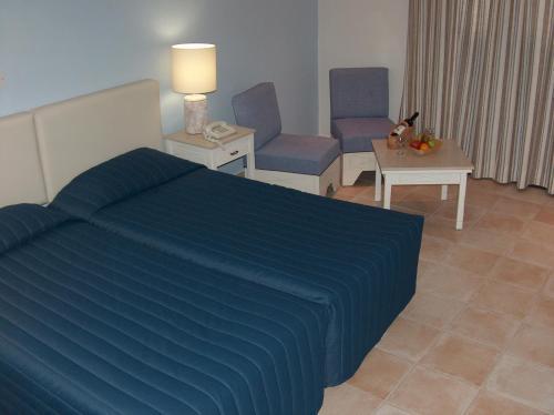 Кровать или кровати в номере Dionysos Central