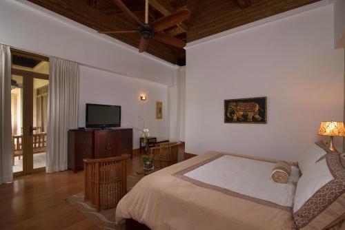 Кровать или кровати в номере Los Altos Residences By Mint