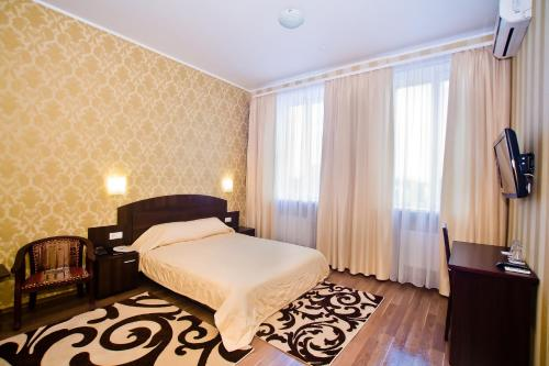A bed or beds in a room at City Club
