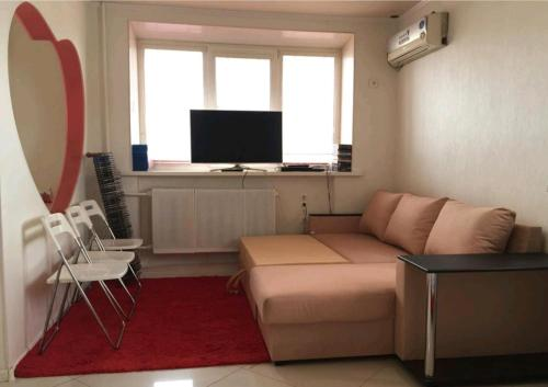 Гостиная зона в De Luxe Apartment on Lenina 40