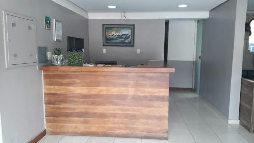 The lobby or reception area at Hotel Gravataí Express