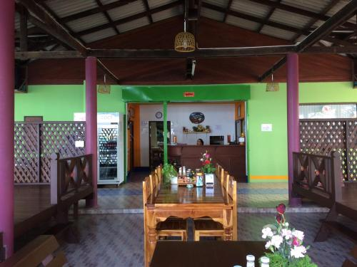 A restaurant or other place to eat at Dragon Hut Resort