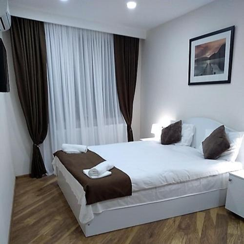 A bed or beds in a room at Luxury studio at Pirosmani 22 in central Borjomi