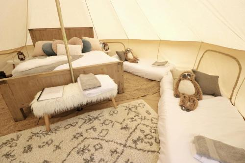 A bed or beds in a room at Starfields luxury camping