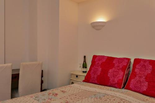Een bed of bedden in een kamer bij Aan de Cauberg