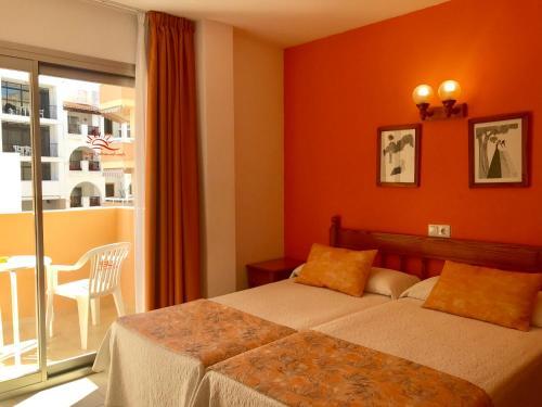 Cama o camas de una habitación en Apartamentos Jovial