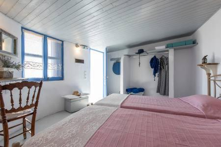 A bed or beds in a room at Emmantina