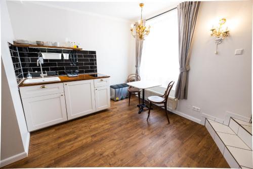 Cuisine ou kitchenette dans l'établissement Boutique Charme Apartment