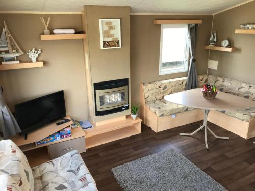 A television and/or entertainment center at Rockley Park - Coral