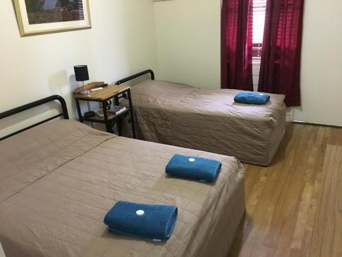 A bed or beds in a room at Brolga Hotel Motel - Coleambally