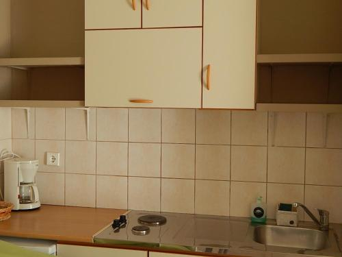 A kitchen or kitchenette at Palmina Mare Villa and Studios