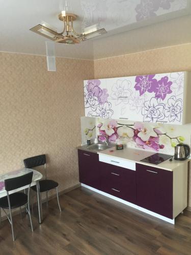 A kitchen or kitchenette at Студия на берегу