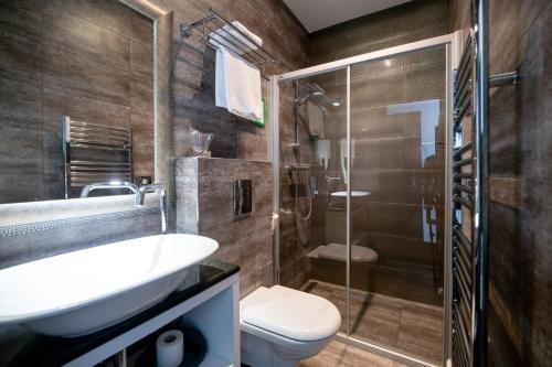 Kupaonica u objektu Log In Rooms