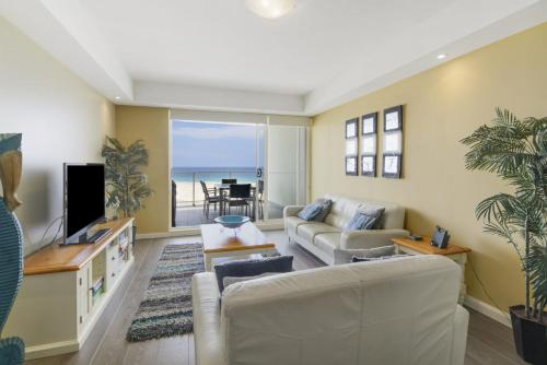 A seating area at Ocean Views, Unit 24