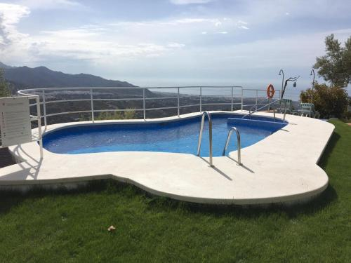 The swimming pool at or near Hotel Rural los Caracoles