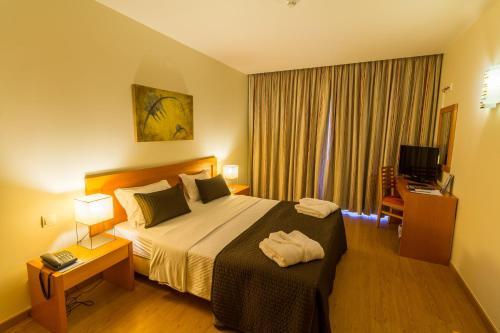 Кровать или кровати в номере Eurosol Residence