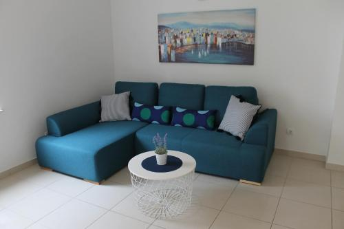 A seating area at Apartman M&M