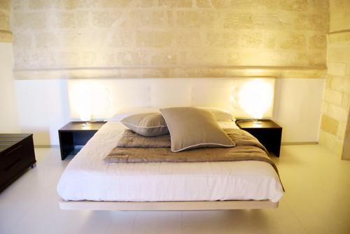 Letto o letti in una camera di B & B Sotto la Volta