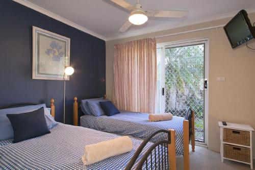 A bed or beds in a room at 1/17 22nd Ave - Sawtell, NSW
