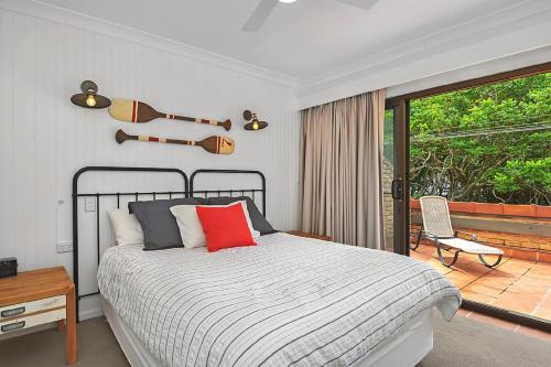 A bed or beds in a room at Beachfront 7 Penthouse - Sawtell, NSW