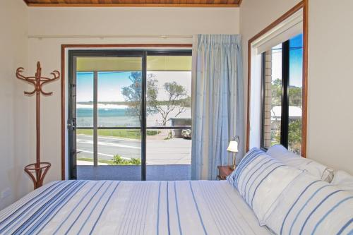A bed or beds in a room at Peninsula - Sawtell, NSW