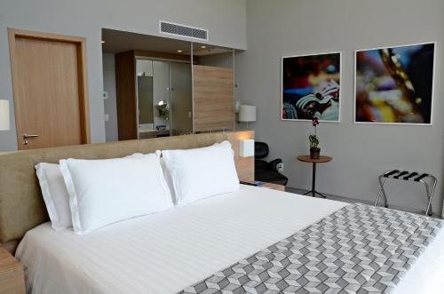 Cama ou camas em um quarto em Bugan Paiva by Blue Tree