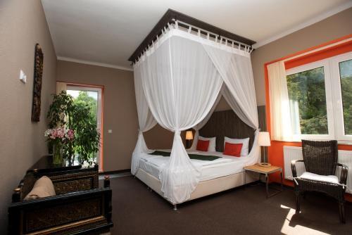 Postel nebo postele na pokoji v ubytování Resort Svata Katerina