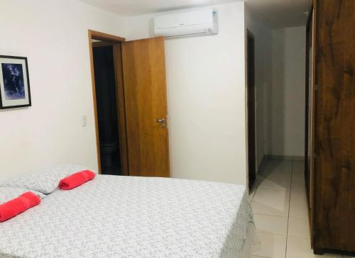 A bed or beds in a room at Residencial Club em João Pessoa