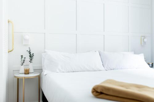 A bed or beds in a room at Cosmo Hotel Boutique