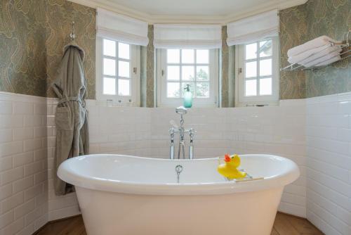 Een badkamer bij Romantik B&B Zonnehuis