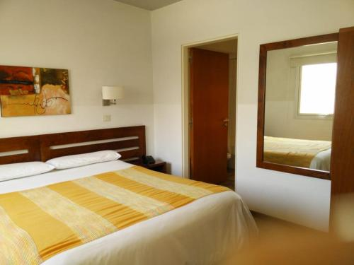 A bed or beds in a room at Piedras Suites