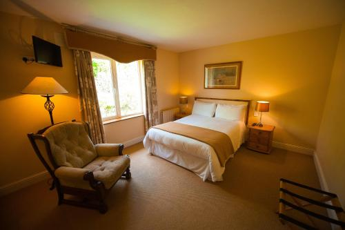 A bed or beds in a room at Park Lodge
