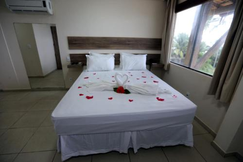 A bed or beds in a room at Pousada Costa do Cacau