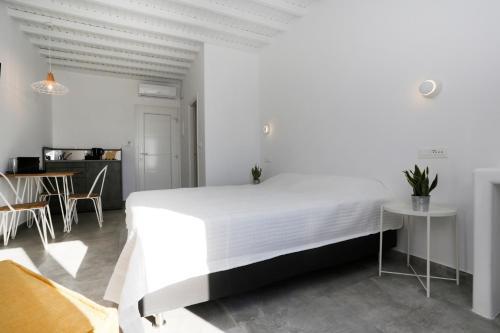 Ένα ή περισσότερα κρεβάτια σε δωμάτιο στο Morfoula's Studios