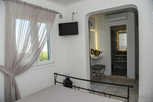 Μια τηλεόραση ή/και κέντρο ψυχαγωγίας στο Porto Manolis