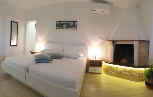 A bed or beds in a room at Apartments Luma