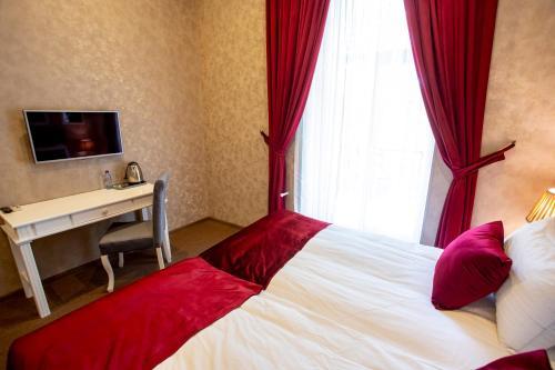 Кровать или кровати в номере La Casa Nizami