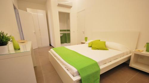 Hotel Novecentoにあるベッド